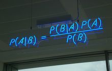 Bayes' theorem - A blue neon sign, showing the simple statement of Bayes' theorem / Bayes' theorem is named after Rev. Thomas Bayes first provided an equation that allows new evidence to update beliefs. It was further developed by Pierre-Simon Laplace, who first published the modern formulation in his 1812 Théorie analytique des probabilités.