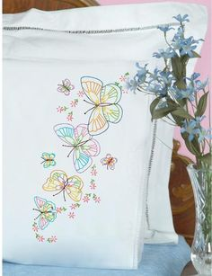 Jack Dempsey Needle Art Fluttering Butterflies Lace Edge Pillowcases Embroidery Kit. Each package contains one pair of standard size pillowcases of cotton/poly