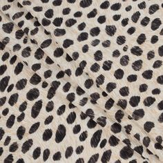 """From the American fashion designer Phillip Lim, here is a courageous striated cheetah printed cotton jersey. Made from cotton, style and love, this printed jersey is extremely soft and contains a subtle 4-way stretch. Translucent in nature, alter this designer fabric into audacious tees, dynamic tops and Spring/Summer dresses. Laying at 50"""" in width and containing a soft and flexible drape, this will be a very easy fabric to work with. Great for sewing your first printed knit!"""