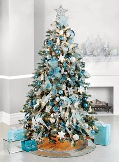 But if you truly want to stand out, we'd suggest you go for a blue Christmas tree this year. we've gathered a list of blue Christmas tree decoration ideas. Teal Christmas Tree, Blue Christmas Tree Decorations, Turquoise Christmas, Christmas Tree Design, Beautiful Christmas Trees, Silver Christmas, Elegant Christmas, Noel Christmas, Christmas Ideas