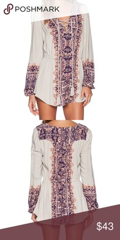 Free People Wildest Moments Tunic Lace-up printed tunic that resonates in chic Renaissance style. 60% viscose, 40% rayon. In great condition. Free People Tops Tunics