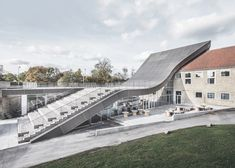 The roof of this cultural centre in Copenhagen, shaped like an elongated S, intends to help the new structure blend with the surrounding hilly landscaping