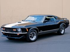 Unless I'm mistaken, this would be a 64 Mustang... and yes, I'm in love. (with the car)