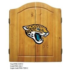 This NFL Jacksonville Jaguars Wooden Dartboard Cabinet Set is made of solid  pine and makes a great gift for the sports fan in your life. This  officially licensed dartboard comes with mounting hardware and six team  logo darts.   Great gift for sports fan Perfect for man cave or garage Made by Imperial International Solid pine wood dartboard cabinet All natural 18-inch bristle dart board Mounting instructions and hardware included Six steel darts with team logo on flights Includes chalk and…