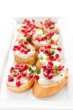 An easy party appetizer, feta cheese is whipped until creamy with sweet and caramelized roasted garlic then spread on toasted crostini.