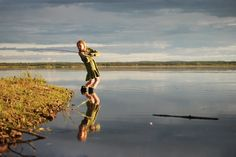 Love this picture of this young girl fishing for PIke in Alaska...reminds me of Hannah in a dress fishing :)!