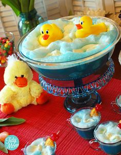 Ducky Bath Baby Shower Punch  Yield: 24 small servings Ingredients    1 packet blue, unsweetened Kool-Aid (Look for Ice Blue Raspberry Lemonade or Berry Blue flavors)  1 (2 liter) bottle Ginger Ale  1 (64 oz) bottle White Grape Juice  1 c  sugar  8 scoops pineapple sherbet  2-3 Rubber Duckies (make sure they float - bathtub toys)  maraschino cherries   orange slices