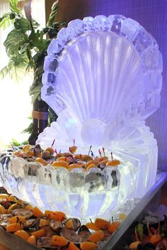 It would only be appropriate to have a seashell ice sculpture for this #OceanCounty #wedding #venue. www.AtlantisBallroom.com #NJ! www.AtlantisBallroom.com #wedding # Perfect for seafood at cocktail hour