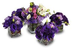 Purple Centerpiece Grouping: <span>Purple and lavender lisianthus accent center arrangement adding a touch of pink and white</span>