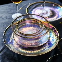 Dine pretty with our Iridescent Gold Tableware that is fit for royalty. Select from our collection of transparent iridescent glass plates and bowls with gold trim. Select all for a luxury collection t Plates And Bowls, Serving Plates, Glass Material, Decoration Table, Iridescent, Home Accessories, Wedding Accessories, Decorative Accessories, Tea Cups