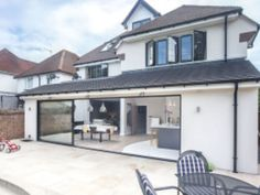External shot of house in Weybridge, fully refurbished by Lofts and Extensions (L&E) House Extension Plans, House Extension Design, Extension Designs, Roof Extension, Extension Ideas, House Design, Conservatory Extension, Conservatory Ideas, Bungalow Extensions