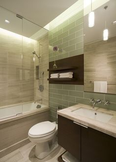 Small bathroom idea- green glass tiles, modern shaped sink. The dark stained wood will date it more quickly; would choose lighter wood.