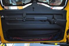 Love the cargo net on bottome too. Springtail MPAC Rifle Scabbard Rack for rear door - Page 5 - Toyota FJ Cruiser Forum