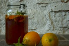sunny days - ice tea with orange and verbena in the making