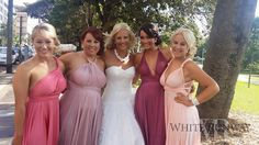 Katie's bridesmaids wore our Goddess by Nature Multi-way dress in 4 shades of pink; Coral Kiss, Dust Me Pink, Sweet Blush and Flirt. #whiterunway