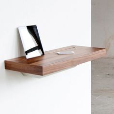 iPhone shelf  Store Away Unwanted iPhone and iPad Cables: Stage Charging Shelf
