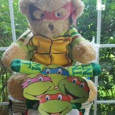This is a newer version of my Ninja Turtle Tricycle Diaper Cake. By Norma's Unique Gift Baskets $88.