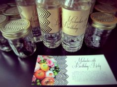 Floral + herringbone invites. Herringbone + craft paper water bottle lables and mason jar tops.