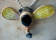 By Cheryl of Chocolate Canary on Etsy.  Pendant, found objects: vintage earring, luggage key, copper wire and a pair of wings that I made myself.