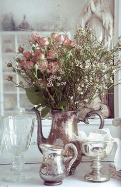 We love the look of this teapot vase! We have several burnished teapots that would look great with bouquets in them like so. http://momentarilyyours.com
