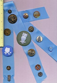 ButtonArtMuseum - Super Card of Owl Buttons - I was fortunate to obtain a friend's Button Collection( 300 cards). This knowledgable collector had good quality buttons and Mounted them beautifully. There are many bargains to be had here. 15 wonderful new and old buttons. featuring OWLS. The pearl on the upper right has glass eyes