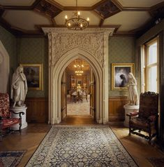 The doorway to the Dining room with the elaborate carved decorations devised by Henry Woodyer -- Tyntesfield -- High quality art prints, canvases, postcards -- National Trust Prints