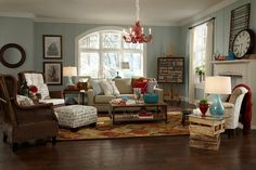 Beach cottage eclectic family room with red and aqua accents