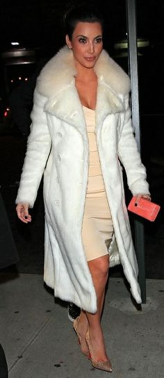 Who made Kim Kardashian's pumps, nude dress and white jacket that she wore in New York? Shoes – Christian Louboutin  Jacket – Prada  Dress – Rachel Roy