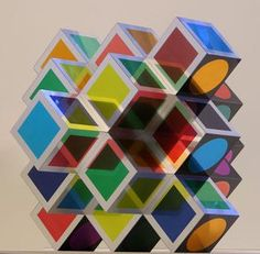 Victor Vasarely - this could be a cool art project. Small cubes with the centers cut out and colored tissue paper or plastic.