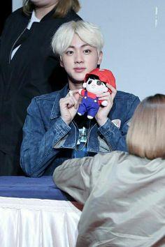 Jin with his Mario plush