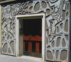 Elaborate concrete doorway, Vienna. It seems to be illustrating the Perseus/Medusa myth!