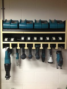 Makita cordless charging station. Very cool. Again, would be great behind cabinet doors, could go on a rolling cart, that slides in behind a cupboard door when done.