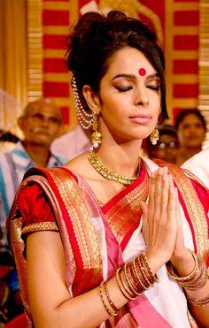 mallika sherawat wearing traditional bengali saree and jewellery