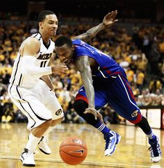 Missouri guard Michael Dixon defends Kansas guard Tyshawn Taylor as he loses control over the ball during the second half of the Missouri vs. Kansas game. The Tigers won 74-71 on Saturday, Feb. 4 at Mizzou Arena. Photo by ANDREW MITCHELL / Missourian.