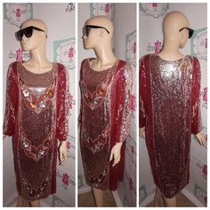 """Up for sale is this lovely Vintage Burgundy Silver Sequins Dress Size M  Flaws: some missing sequins in certain spots barely noticeable  Material:  silk  Shoulder Pads: yes Pit to Pit: """" 20 Sleeve: """" 15 Overall Length: """" 42  PLEASE READ Below Tag size on vintage clothing doesnt match current clothing sizes. Please compare the actual garment measurements below to your own clothing (not your body) to determine fit. Measurements have been taken with the garment lying flat. They have not been…"""