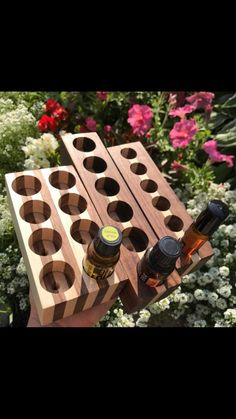 Walnut and Maple essential oil holders. these are made to hold roller, or bottles. these can be customized with wood species and the amount they hold, just shoot me a message. Essential Oil Holder, Essential Oil Shelf, Essential Oils, Doterra, Wooden Pallet Furniture, Wooden Pallets, Ladder Shelf Diy, Recording Studio Design, Oil Storage