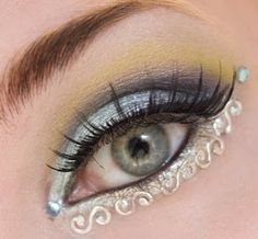 silver and yellow with rhinestones and embellishments