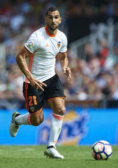Martin Montoya of Valencia runs with the ball during the La Liga match between Valencia CF and Atletico de Madrid at Mestalla Stadium on October 02, 2016 in Valencia, Spain.