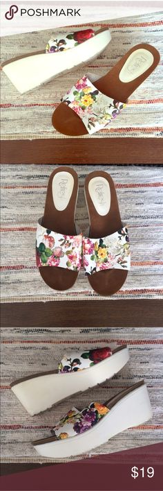 "90's Style Floral Flatform Sandals Super cute white floral Flatforms in size 8.5. Fit true to size. Fun 90's style shoes. Worn less than 3 times. 1.5-3"" platform sole. Some small signs of wear on the soles.  •I don't swap/trade •I don't do holds  •I rarely model due to the fact that I don't fit all items.  •I price with shipping in mind  •I am open to reasonable negotiations  •Bundle for the best deals  ☮   ❤️   😊 Shoes Wedges"