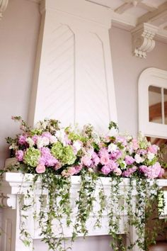Don't overlook adding flowers to other areas in your ceremony and reception location besides tabletops and arches. Fireplace mantles are the perfect showcase for pretty floral displays.