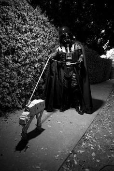 Darth Vader walking the dog.
