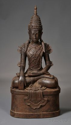 Carved Wood Buddha, Burma, 20th century, depicted seated on a pedestal with his hands in bhumisparsha mudra and adorned with flowers, ht. 42 in