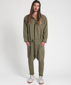 b953852a14d The Khaki Worker Suit is a one-piece staple jumpsuit cut from a tough
