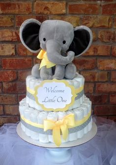 Diaper Cake Elephant 2 Tier Extra Large Stuffed Elephant Baby Shower Centerpiece Diaper cakes start out as beautiful gifts or decorations, often used . Elephant Baby Shower Centerpieces, Baby Shower Decorations Neutral, Baby Shower Yellow, Baby Shower Fun, Cute Baby Shower Gifts, Baby Shower Diapers, Baby Shower Cakes, Diaper Cake Centerpieces, Cake Decorations