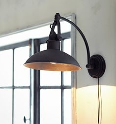 wall lamp above sofa in living room (Teal color)