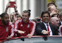 Party-time: Gareth Bale and Chris Coleman enjoy the atmosphere as the Wales squad are welcomed home by thousands of fans in Cardiff