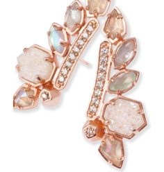Ear Climbers are on trend and follow the natural curve of the earlobe. These rose gold ear climbers in drusy, mother-of-pearl, and opal dress up any look.