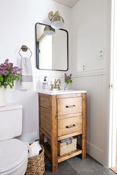 A small bathroom is made over into a classic, modern rustic bathroom on a budget! This small bathroom makeover used lots of budget-friendly DIY projects to transform a half bathroom! Bathroom Renos, Bathroom Renovations, Bathroom Storage, Bathroom Cabinets, Bathroom Faucets, Small Bathroom Vanities, Wooden Bathroom Vanity, Decorating Bathrooms, Bathroom Hacks