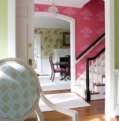Modern way to decorate with floral wallpaper - large scale, bright colors, glossy white accents