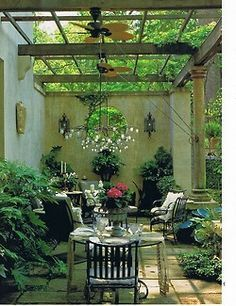 This would be great if you had neighbors or a street on one side. the round opening is a good touch.I like the outdoor fans on the supports.Very lushly green & relaxing space.